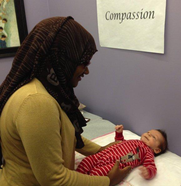 Midwife Faisa Farole examines (Stuteville's son) Malcolm Stonehill